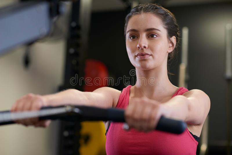 Woman In Gym Exercising On Rowing Machine royalty free stock photography