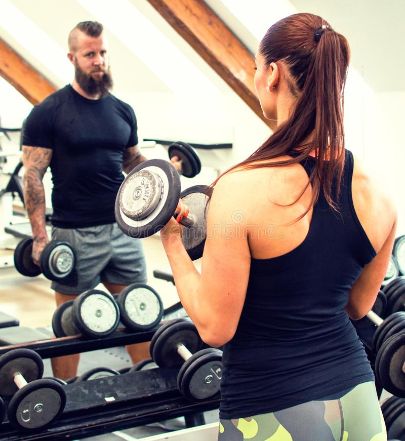 Woman in a gym looking at the mirror. royalty free stock image