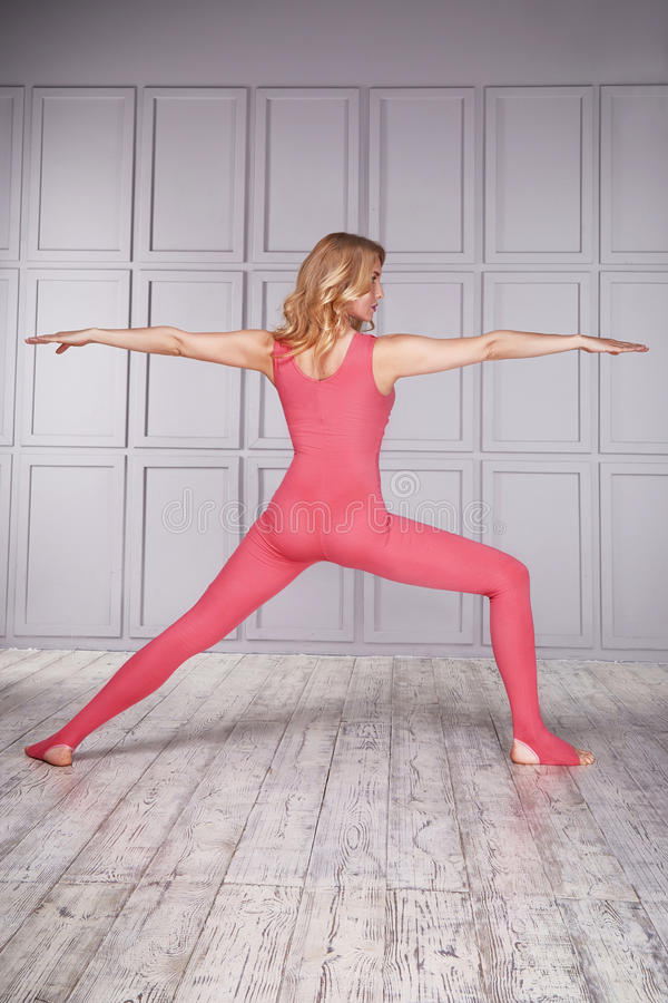 Woman gymnast athlete beautiful blonde dressed in a special costume for fitness yoga sport tight-fitting clothing made of nylon. Diet nutrition, stretching royalty free stock photography