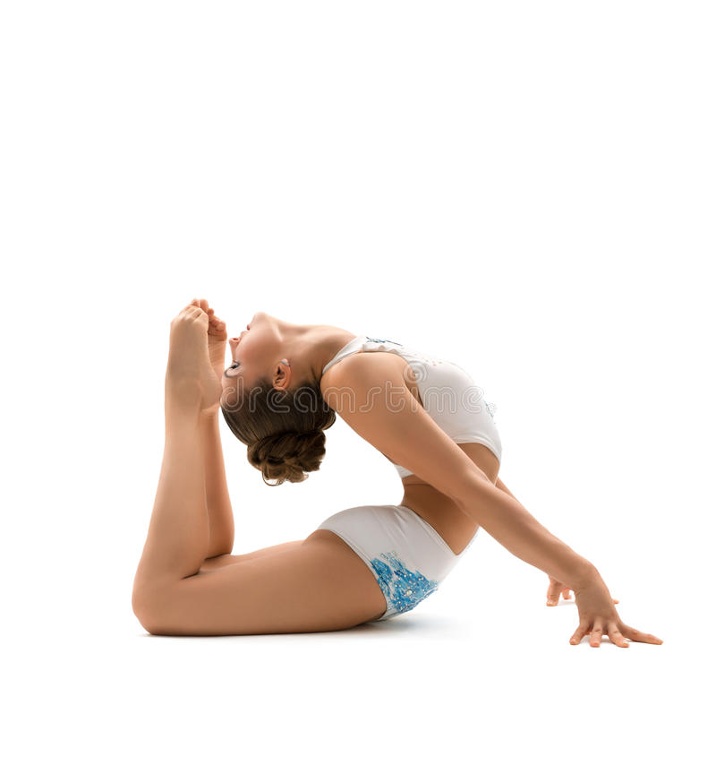 Woman gymnast isolated on white background. Beautiful female gymnast stretching and exercising , isolated on white background. Young athletic woman in bright stock photo