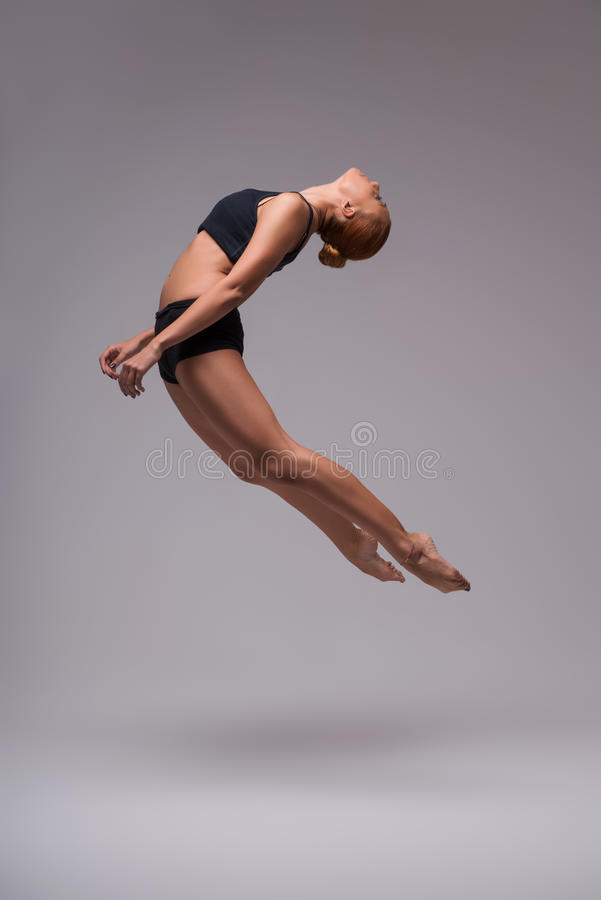 Woman gymnast stretching royalty free stock image