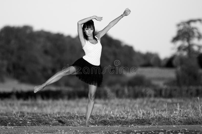 Woman in gymnastics at the first sunlights. royalty free stock images