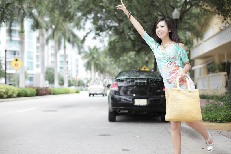 Download Woman hailing a cab stock photo. Image of beautiful, attractive - 14941398