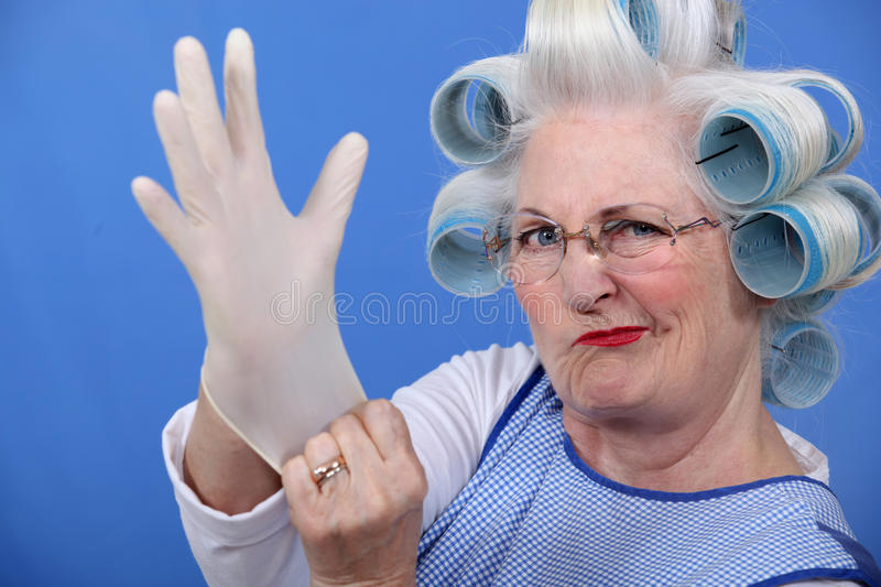 Woman with hair curlers stock photography