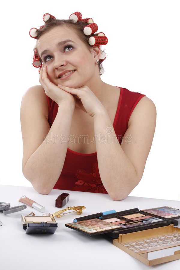 Woman In Hair Curlers Thinks About Something. Stock Image