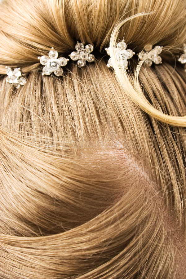 Woman hair with hair-pins.  stock photo