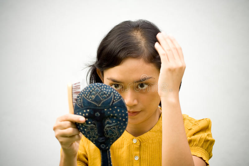 Download Woman With Hair Loss Problem Stock Photo - Image of mirror, comb: 10091350