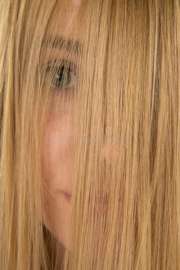 Woman hair over eyes closed stock image