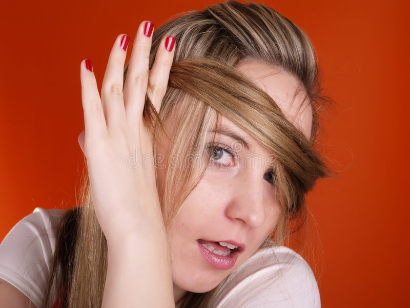 Woman with hair over her face. Beutiful young woman with long hair over her face stock image