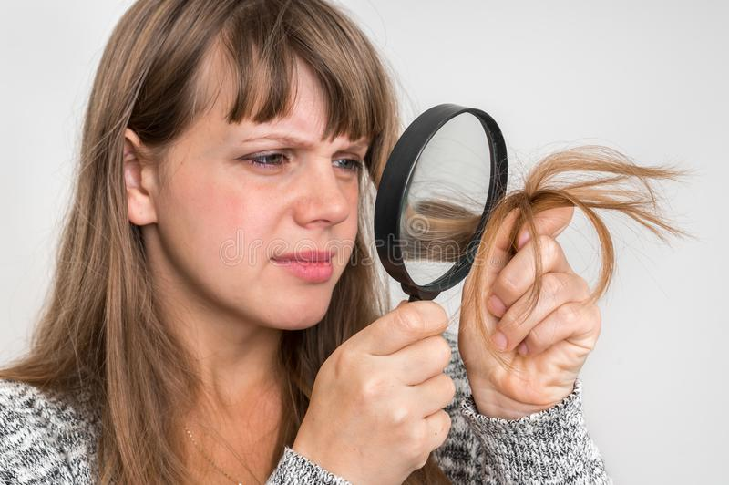 Hair problems - brittle, damaged, dry and loss hair concept stock photography