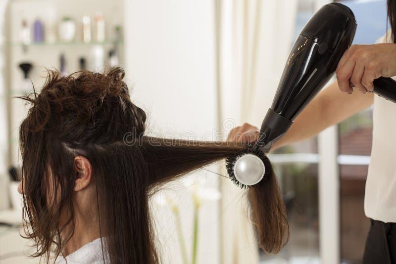 Woman in a hair salon royalty free stock photos