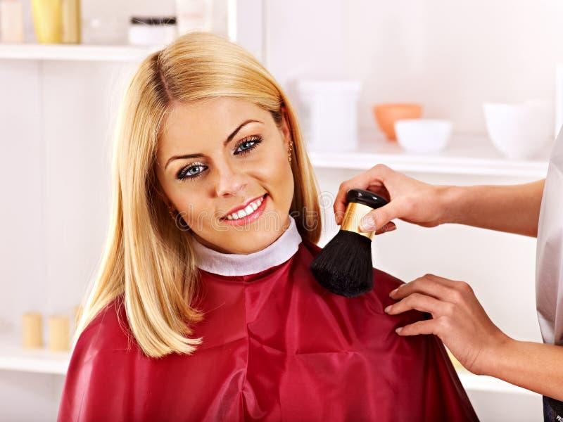 Woman at hairdresser. Woman at hairdresser with iron hair curler stock image