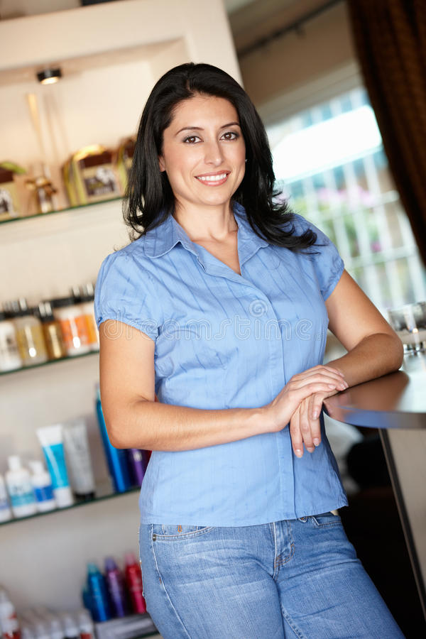 Woman hairdresser standing in salon. Smiling at camera stock images