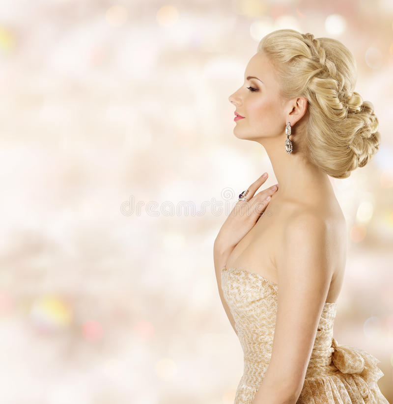 Woman Hairstyle, Fashion Model Face Beauty, Girl Blond Hair Style. Woman Hairstyle, Fashion Model Face Beauty, Girl with Blond Hair Style and Jewelry, Smelling royalty free stock photography