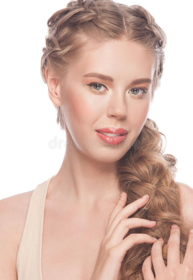 Woman with hairstyle tress. Blond Hair. Young Beautiful Caucasian Woman with Hairstyle Tress and Makeup. Isolated on white background stock photography