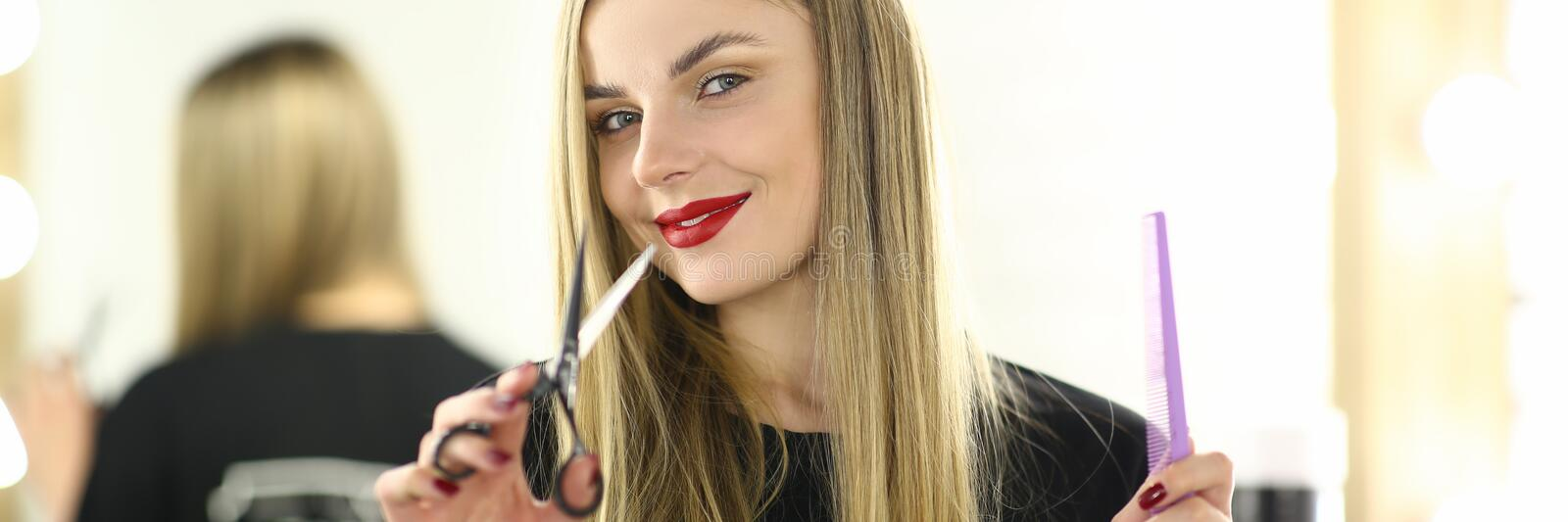 Woman Hairstylist with Comb and Scissors in Hands royalty free stock photography
