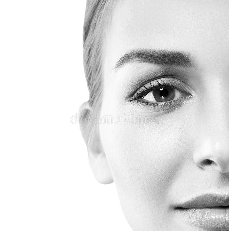 Woman half-face black and white stock photography