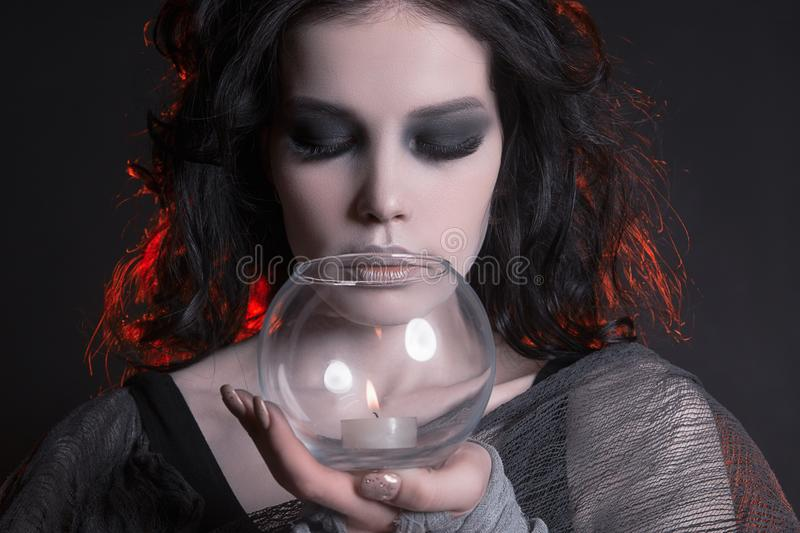 Woman with halloween make-up holding a candle stock images