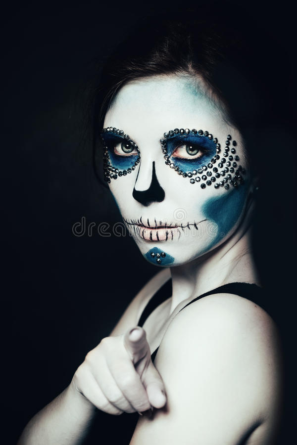 Woman with Halloween Makeup. Sugar skull Beautiful Model stock photography