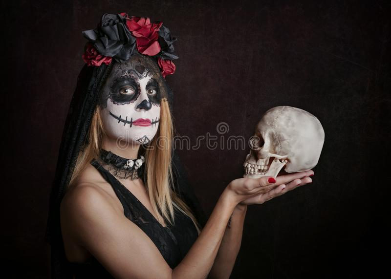 Woman on halloween. At red background stock photos