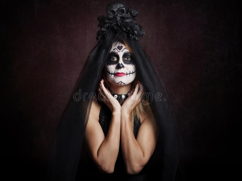 Woman on halloween. At red background stock image