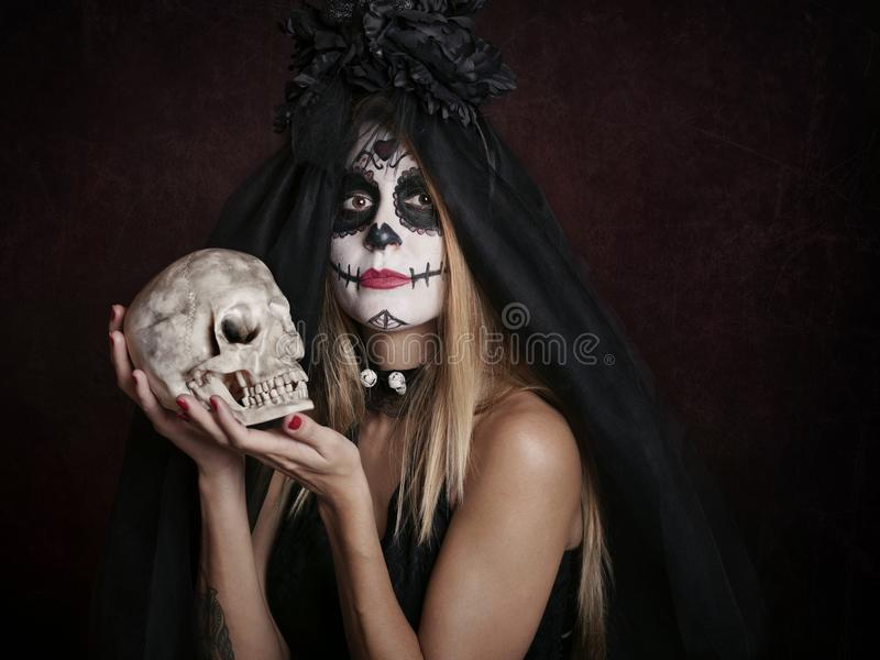 Woman on halloween. At red background royalty free stock images
