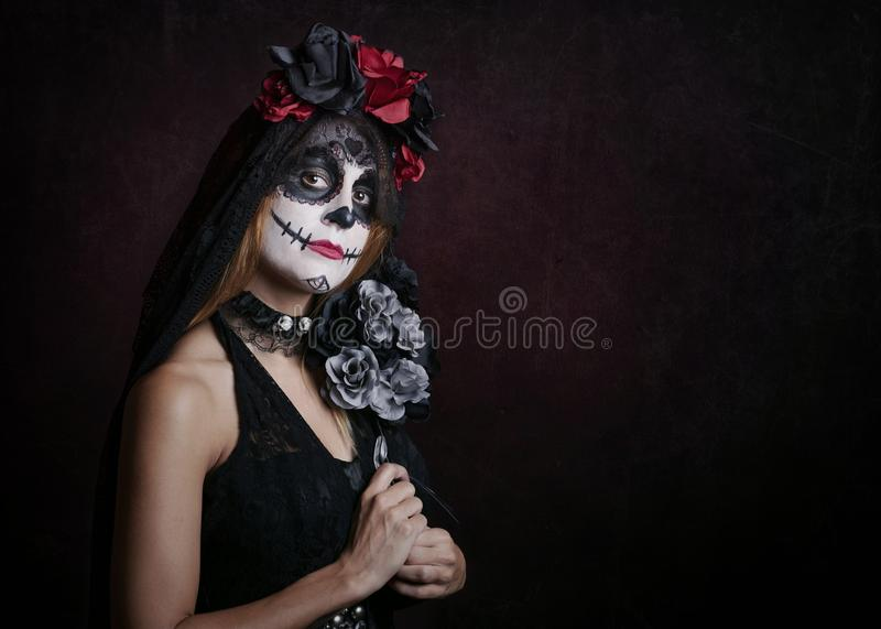 Woman on halloween. At red background royalty free stock photo