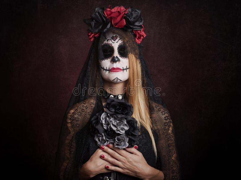 Woman on halloween. At red background stock photo