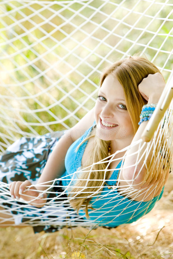 Woman in hammock. Portrait of woman resting in hammock royalty free stock images