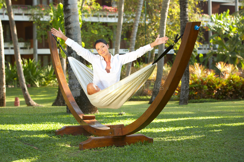 Woman on hammock. 20-25 years woman portrait ralaxing on hammock at exotic surrounding, bali indonesia royalty free stock photography