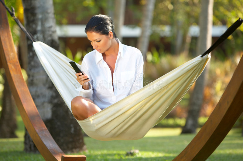 Woman on hammock stock photos