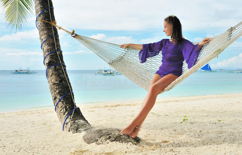 Woman in hammock on beach stock photos