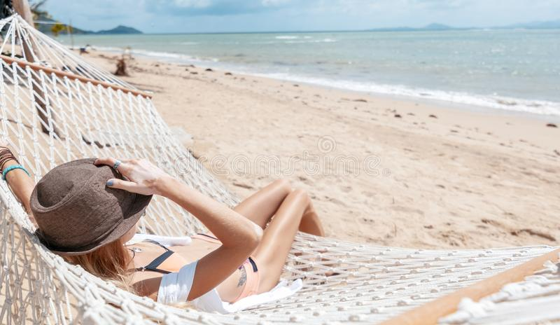 Woman on hammock. Lifestyle concept. Summer vacation. Nature concept. Summer tourism, travel. stock photo