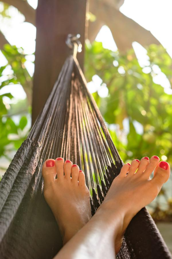Woman in hammock on beach royalty free stock photography