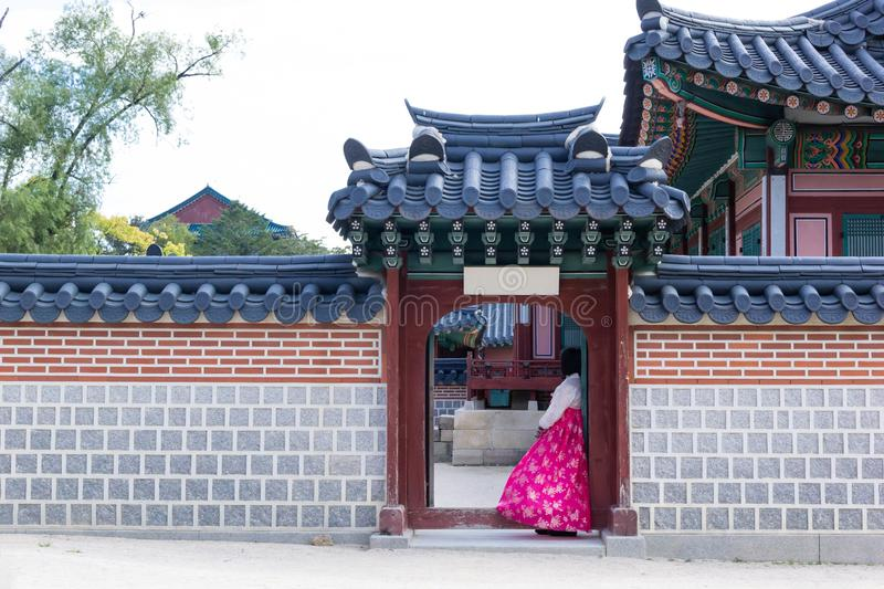 Woman in Hanbok dress with ancient Korean palace royalty free stock photos