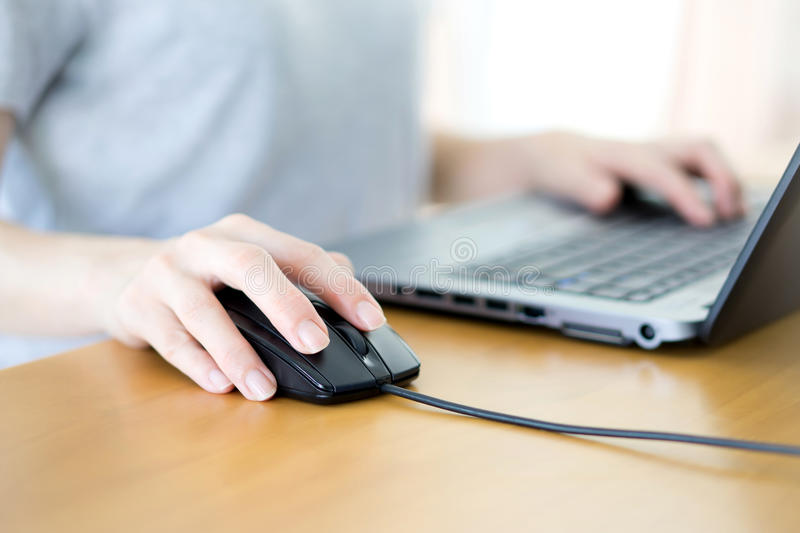 Woman hand clicking mouse outdoor royalty free stock image