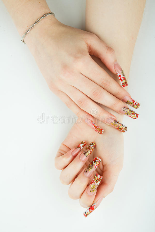 Woman hand close-up with beautiful manicure on white background royalty free stock image