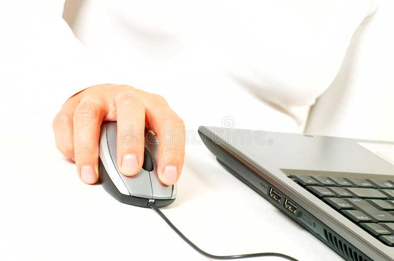 Woman hand on computer mouse. On white background royalty free stock image
