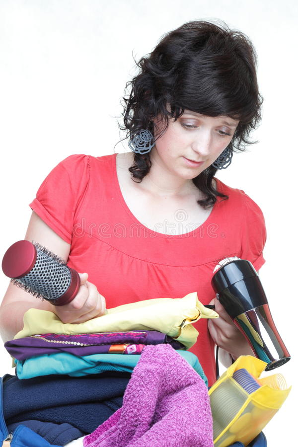 Download Woman Hand Crammed Full Of Clothes And Shoulder Bag Isolated Stock Image - Image: 29861187