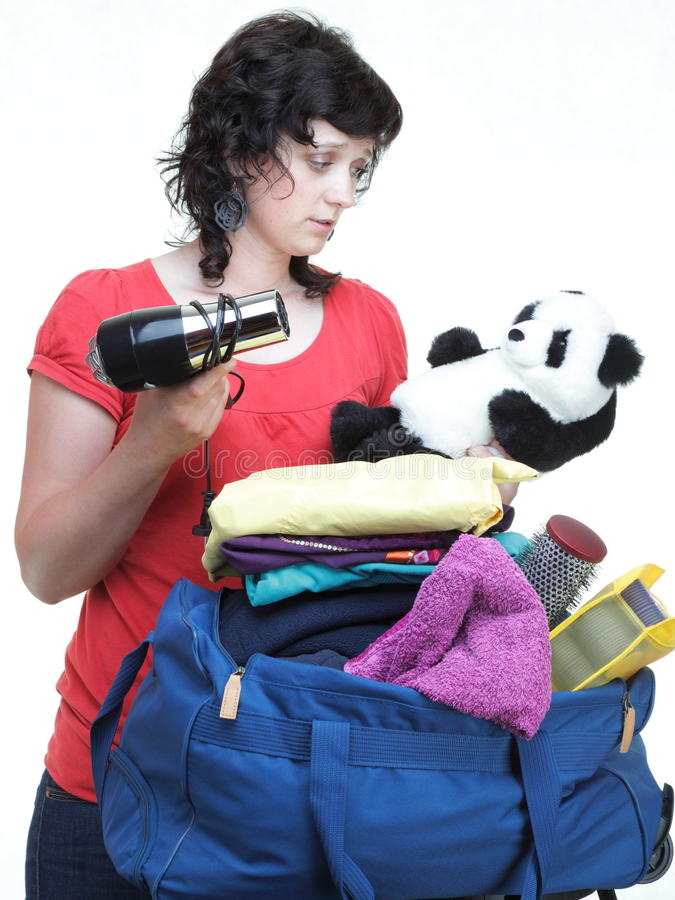 Download Woman Hand Crammed Full Of Clothes And Shoulder Bag Isolated Stock Image - Image: 31615081