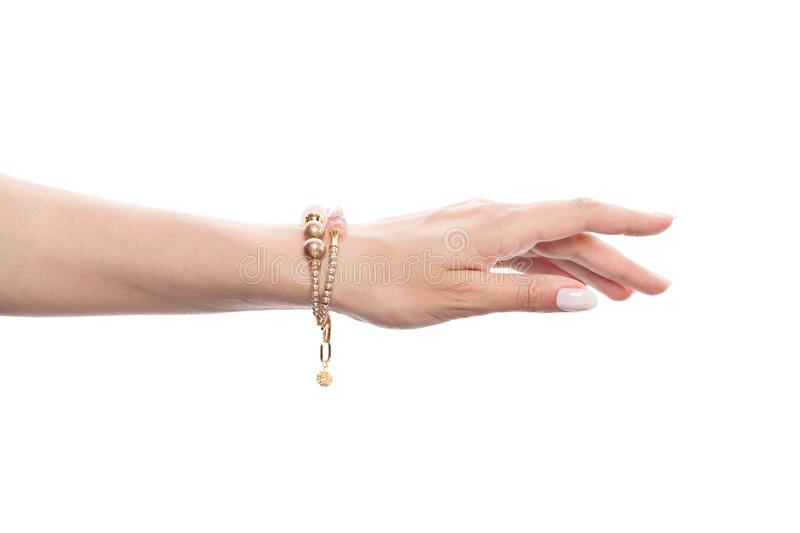 Woman hand in fashion jewelry bracelet isolated on white background.  royalty free stock photography
