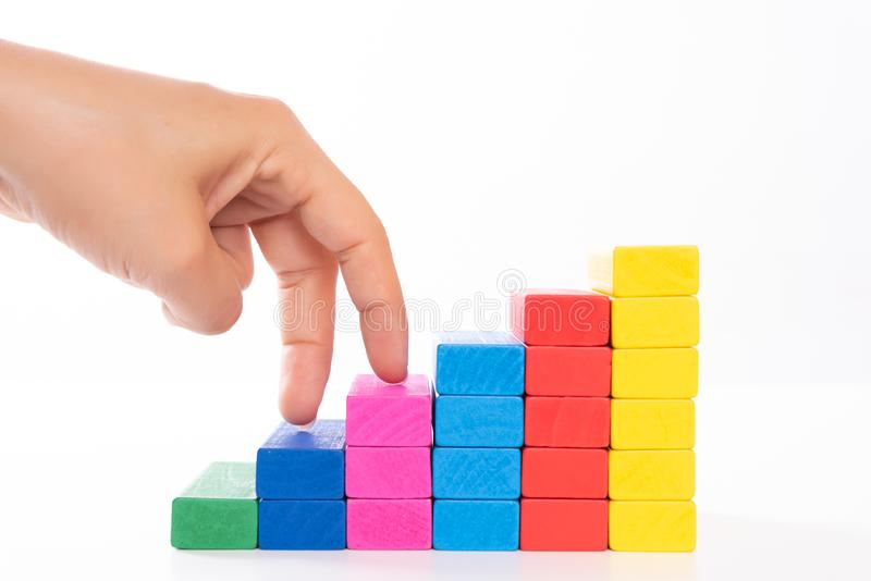 Woman hand finger walk on stacked wooden block like stairs. Business development and growth concept stock image