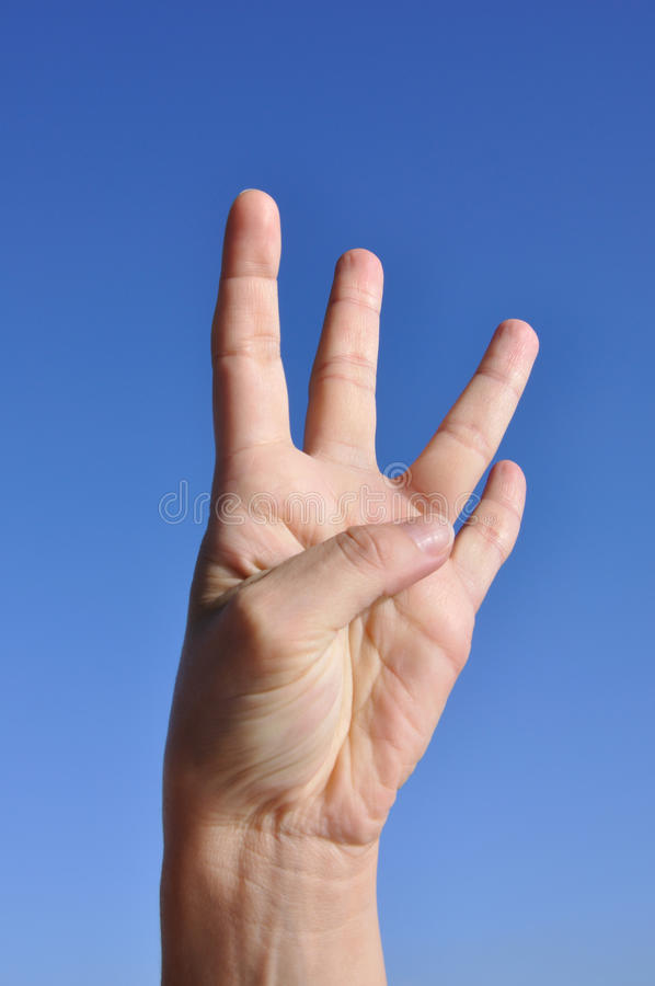 Woman hand - four fingers stock photography