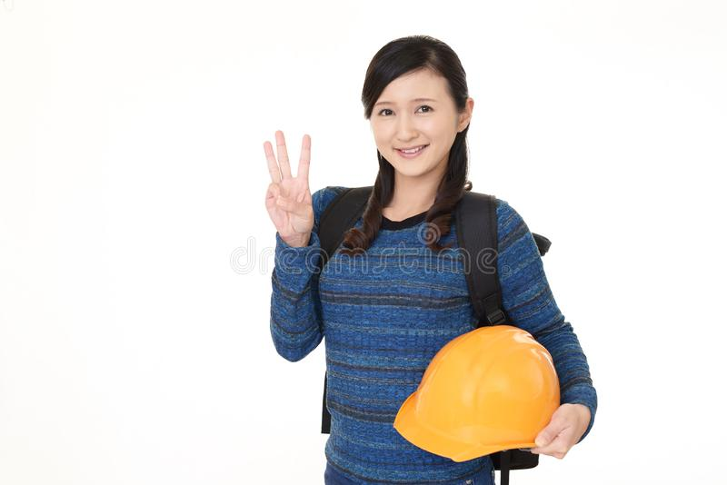 Woman with a protective helmet. royalty free stock photo