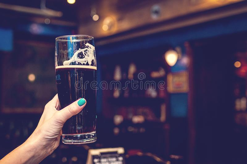 Woman hand with glass of beer stock images