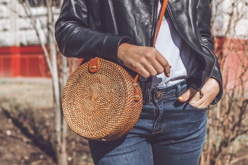 Woman hand with handmade organic rattan handbag. Rattan bag. Outdoors, Europe. Woman hand with handmade organic rattan handbag. Rattan bag royalty free stock photos