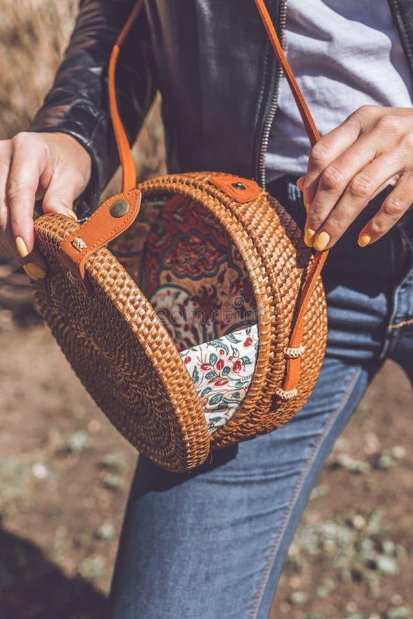 Woman hand with handmade organic rattan handbag. Rattan bag. Outdoors, Europe. Woman hand with handmade organic rattan handbag. Rattan bag royalty free stock images