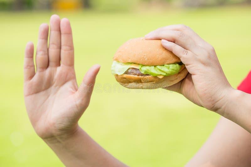 Woman hand hold hamburger stock images