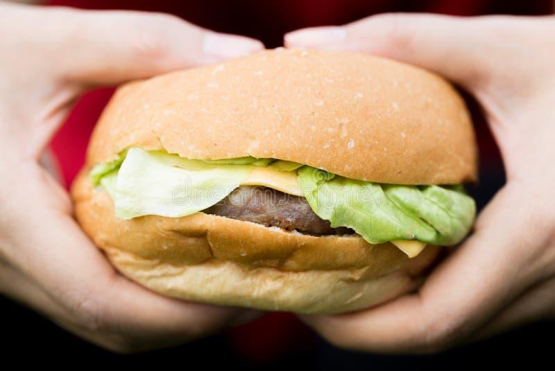 Woman hand hold hamburger royalty free stock photos