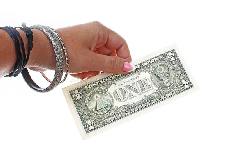 Woman hand holding american money dollar bill on isolated white cutout background. Studio photo with studio lighting stock image